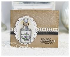 Glittered apothecary bottle stamp from Graphic 45.