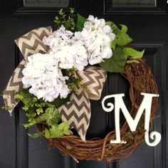 Housewarming Gifts for Newlyweds:  Spring Monogram Initial Hydrangea Front Door Wreath with Bow by Jenny C Moon @ Etsy