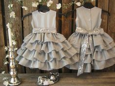 Silver flower girl dress with sequin embellished sash. Taffeta girls ruffle dress for that special occasion; winter wedding or birthday party. Wedding Flower Girl Dresses, Little Girl Dresses, Girls Dresses, Flower Girls, Gray Dress, Ruffle Dress, Grey Flower Girl Dress, Dress Skirt, Winter Flower Girl