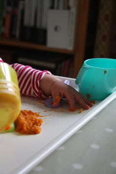 First forays into food...  Weaning 6 month old baby  Doidy cup    sittinginthekitchensink.blogspot.co.uk 6 Month Old Baby, 6 Month Olds, Plastic Cutting Board, Blog, Blogging