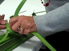 """A lesson in """"palm weaving"""" from Donna at Our Lady of Grace C"""