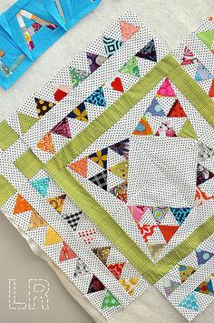 LR Stitched - Mini quilt with a lot of precision work with Triangles. Love the polka dot background!