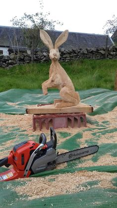 Chainsaw carved hares.