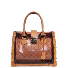 This is an authentic LOUIS VUITTON Ambre Neo Cabas MM.   This chic tote is crafted of amber Louis Vuitton monogram print vinyl.