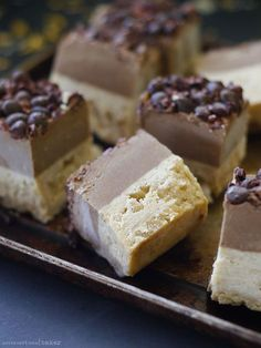 Raw vegan carob coconut protein bars with a lovely chewy fudge layer + a soft creamy carob top. Gluten-free, dairy-free, nut-free, refined sugar-free.
