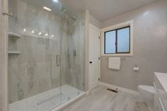 Frameless Showers | Binswanger Glass Grey Bathrooms, Modern Bathroom, Frameless Shower Enclosures, Glass Shower Doors, Corner Bathtub, Stock Photos, Showers, Adobe