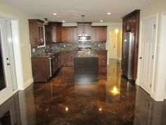 Stained Concrete Floors Ideas With Dark Wooden Kitchen Island And Countertop Design