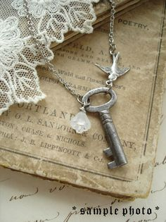 I really like this! Antique Skeleton Key Necklaces. Rustic Wedding Jewelry. Vintage Key Necklace with Flower and Bird. Garden Wedding.