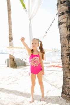 bd8f466255465 Marlowe Martino wears a pink and gold floral bathing suit on the beach in  miami as