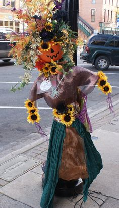 Floral Designs of Hastings 2015 scarecrow. The yearly scarecrow contest is part of the annual Hastings, MI Girls Night Out Event
