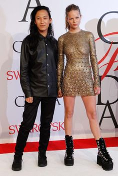Alexander Wang and Anna Ewers, in a dress and shoes by the designer