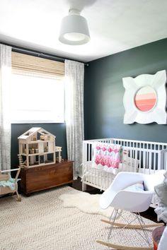 bright nursery with dark walls, west elm herringbone and jute rug, vintage dollhouse, eames rocker
