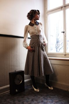 """The """"Ticket To Ride"""" skirt in warm flanell goes to mid calf, with 3 small buttons at the high waist; looks so chic with flat leather boots or patent leather hee"""