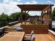 ~ This Chicago rooftop features a cedar pergola with lounge seating and fire pit as well as a built-in grill and bar area and dining space ~