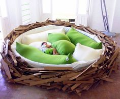 birds nest bed, i could make this for my nieces......just a kiddie pool, fluffy stuff, and cardboard straw.....done. :)