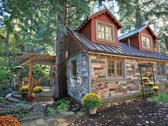 Guests say the pictures fall short of showing off this charming storybook setting. Imagine a quaint Stone Cottage surrounded by huge pines, a secluded Hot Tub across a stone bridge nestled next to a mountain stream, ...