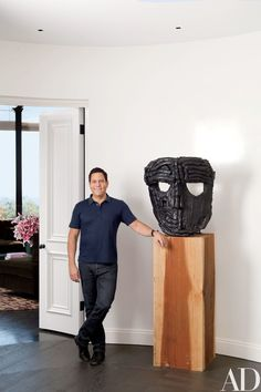 TV producer Darren Star holds court in his Los Angeles residence, which was renovated by Mark Rios of Rios Clementi Hale Studios and decorated by Waldo Fernandez of Waldo's Designs; the sculpture is by Thomas Houseago. Thomas Houseago, Hollywood Homes, Thing 1, Celebrity Houses, Home Photo, Architectural Digest, Bel Air, New Life, Classic Hollywood