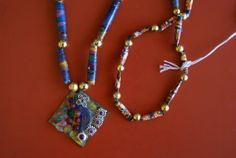 Necklace by Cathy. Handmade paper beads and pendant made from scraps.