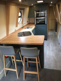 The Boathouse: a new definition to lakefront living! Narrowboat Kitchen, Narrowboat Interiors, House Boat Interiors, Canal Boat Interior, Dutch Barge, Houseboat Living, Boat Lift, Tiny House Movement, Boat Design