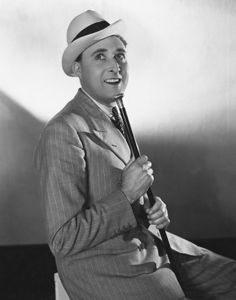 """Max Miller, """"The Cheeky Chappy"""", was Britain's top comedian of the 1930's and 40's. He excelled as a stand-up comic playing to large audiences in variety theatres.  Mischievous, brash and quick-witted, he was a master of the double entendre."""
