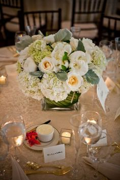 lace table cloth, tea lights, gold flat ware, glass, china, hydrangeas + roses