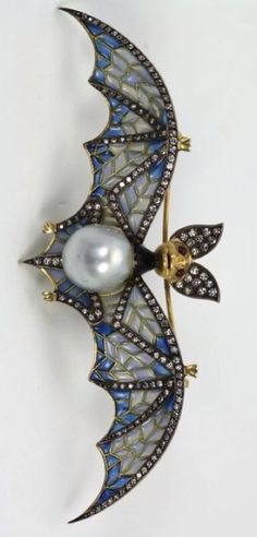 "Bat pin of plique-a-jour enamel, pearl, diamond, with ruby eyes, 18k gold, 4"" wing span 