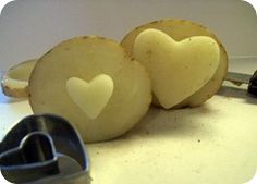 Carved heart-shaped potato stamps.