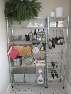 Love some of the ways they've used metal shelves for kitchen storage.