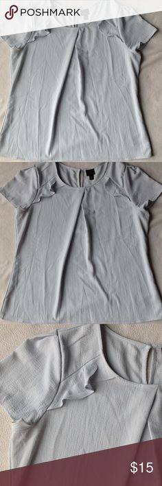 Ruffle blouse Short sleeve, ruffle in font by each shoulder, keyhole in back, color is very light blueish green. Worthington Tops Blouses