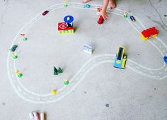 Sidewalk Chalk Town 🚓🚦 • It's a beautiful Friday morning, and we took our cars and toys outdoors to play & enjoy the weather! ☀️ I drew some simple roads with chalk, and we added some toys to create a little town to cruise through! 🚙⛽️🚧 #kidsactivities