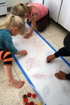 I would buy Butcher Paper at the grocery store, roll it out and give my boy's water color paints, crayons and stamps to get creative on rainy days. Still have those masterpieces. Loads of fun. But this is a good idea too LEAF RUBBING @amy nelson-s