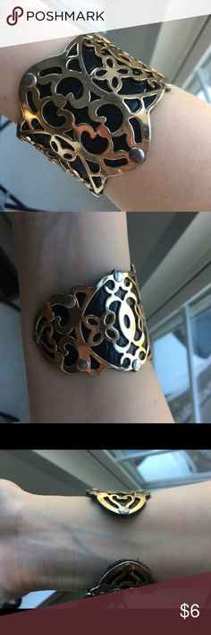 Filigree Cuff Bracelet Beautiful statement piece. Black cuff bracelet with gold filigree design. Pictures show areas where the gold has rubbed off a bit but not that noticeable when worn, in my opinion. Cuff size adjusts with your hands. 🌻 Forever 21 Jewelry Bracelets
