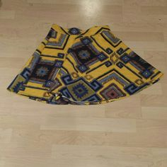 Yellow Aztec patterned skater skirt Cute and springy! Size small skater skirt with Aztec pattern. Xhilaration Skirts Mini
