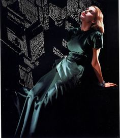 She's painting the town emerald! vintage 1940s fashion dress green evening gown long dress short sleeves satin color photo print ad model magazine portait