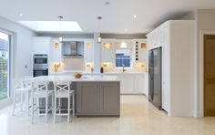 An in-frame kitchen with a shaker door, painted in Strong White and Charleston Grey by Farrow & Ball. The colours present in the kitchen combined with the feature lighting throughout helps to create a clear,crisp and clean look that would impress anybody upon first glance.