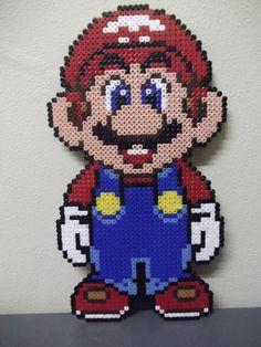 Super Mario perler beads by beadstoterabithia