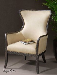 Excellent take on a traditional wingback chair.  Everything old is new again.  www.barbabrahamdesigns.com