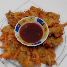 INDONESIAN CORN FRITTERS RECIPE This one is called Bakwan Jagung or Fried Corn Fritters and is one of the favorite snacks in Indonesia. It's a delicious fried snack and the main ingredients are corn, vegetables and sometimes you can also add prawn or cabbage.