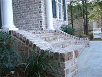 Brick Wing Walls flanking our front steps. Front Steps Stone, Concrete Front Steps, Brick Steps, Brick Walkway, Front Porch Stairs, Entry Stairs, Porch Steps, Front Porches, Exterior Wall Design