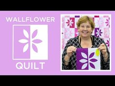 Okay, so the materials that you will need to create the wallflower quilt includes two packets of ten-inch squares, one that is a solid color and another that is patterned. Jenny uses white for her solid color and the pattern she uses is called Pinking of You, by Wilmington. Even though the video …
