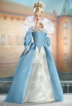 Princess of the Danish Court™ Barbie® Doll  Princess of the Danish Court™ Barbie® doll rules proudly. She is dressed in a beautiful light blue, ivory, and golden gown decorated with lace and a golden bow. Her luxurious blonde hair is upswept. Finally, she wears dangling golden earrings, a golden ribbon choker, and a regal crown to show her royal station.