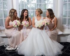 This year's hot wedding colors of white/ivory, blush and gray accents in mixed rose and peony bouquets from Seasonal Celebrations. Photo courtesy of Duende Photography.