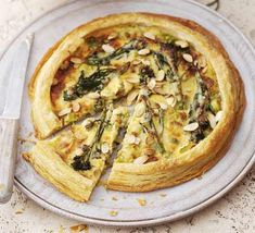 Purple sprouting broccoli, leek & almond tart. This stunning vegetarian tart is no trouble to make, as it's made with a packet of puff pastry