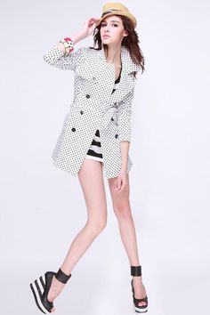 Trench coat made of cotton and spandex, featuring all over contrast color polka dot detail, turndown collar with long sleeves, open front with double breasted button front closure, a wide belt with slim fit.$116