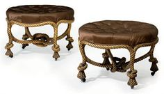 A NEAR PAIR OF NAPOLEON III GILTWOOD STOOLS (TABOURETS)   IN THE MANNER OF FOURNIER, LATE 19TH CENTURY   Each circular deep-buttoned seat covered in brown silk, on rope-twist frames with horn casters, one stamped T, minor variations  24 in. (61 cm.) diameter  16250 against a pae of 5-8