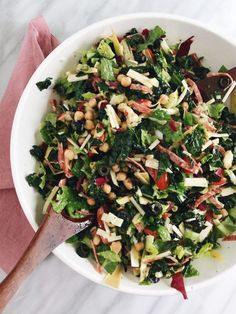 This Italian Chopped Kale Salad combines kale, radicchio, and romaine with all of the delicious goodies typical of an Italian chopped salad and a tangy Lemon Oregano Vinaigrette.