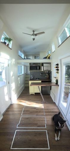 Great design for stairs and loft space with back door going out onto a deck! Emilys 24 Tiny House on Wheels by Trekker Trailers 003