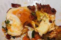 Baked eggs with lots of extra stuff in the bottom.