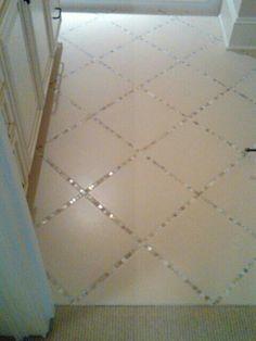 Glass tile surrounds ceramic tile.