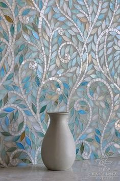 WOW, that's some stunning tile! Leaves and Vines in glass Quartz and Aquamarine.